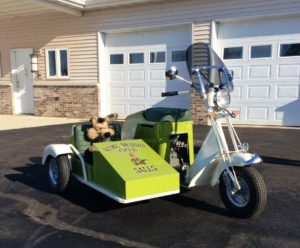 August 2018 | 1948 Cushman step-thru with side car. Professionally restored. New 8HP motor and carb. Rebuilt transmission, 2-speed forward plus reverse.